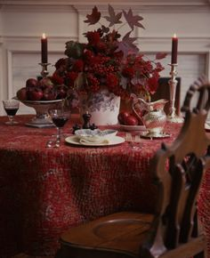 The red French boutis I bought in Provence years ago inspired this table, with a quick  bouquet of red Japanese maple leaves, red dahlias, and red viburnum. I surrounded this large bouquet with plates and compote dishes of apples from the orchard.