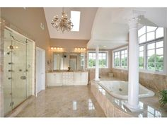 This bathroom is perfect for being pampered. It includes a large multi-head steam shower, separate commode, over sized Jacuzzi and an array of windows and skylights. #NJ #RealEstate
