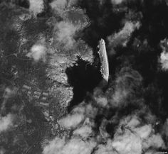 capsized Costa Concordia from SPACE!!!