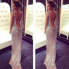 Wearing Mac Duggal Style 3434A in Gold. Long prom dress with open back and long sequin train.