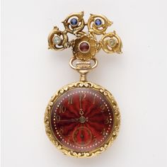 [Reverse] GOLD AND COLORED STONE PENDANT-WATCH, T.B. STARR, CIRCA 1900 The circular case and fan-shaped brooch decorated with florets and meandering foliate scrolls, set with various round colored stones including garnets, sapphires, chrysoberyls and citrines, reversing to a deep red guilloché enameled dial, with applied gilt arabic numerals, filigree hands and subsidiary seconds dial, brooch and case signed T.B. Starr.