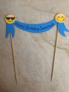 DIY Emoji cake topper. We couldn't find an emoji cake topper to save our lives so we made our own! Two bamboo skewers, construction paper, glue & a couple markers is all it took.