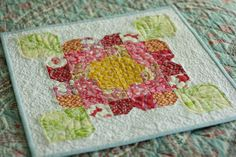 Inspiration for a quilted pillow case for Flower. DC    a bloom mini quilt by @Jessica Twin Fibers