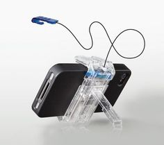 The ZHIP Stand with 3 Feet of Retractable Zip Cord for iPhone, iPod and All Other Smartphones by SurfShelf, LLC, http://www.amazon.com/dp/B004DB38UG/ref=cm_sw_r_pi_dp_Nvvisb0C6THRF