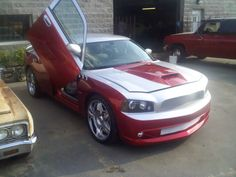 White Dodge Charger with hood decals, side stripes, door