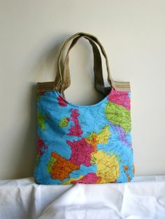 The whole world in your hand map tote bag With by madebynanna