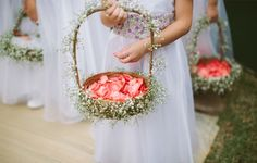 Flower girls basket with petals from pink roses