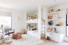 White and bright neutral girls bedroom design with built in bunk beds, built in shelving and tones of blush - Amber Interiors