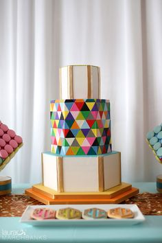Bright geometric pink, turquoise, purple, orange, gold wedding cake and cookies by The People's Cake.  Weddings in Woodinville photographer Laura Marchbanks captures geometric wedding details at Columbia Winery designed and coordinated by Simply Wed. Laura Marchbanks Photography, Seattle Wedding Photography. White Wedding Cakes, Beautiful Wedding Cakes, Beautiful Cakes, Gold Wedding, Geometric Cake, Geometric Wedding, Pretty Cakes, Cute Cakes, Striped Wedding