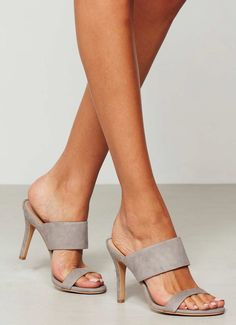 Web Exclusive - Opt for these grey suede slip on heeled sandals for a glamorous look. Thes will be perfect for those evenings out. Available in sizes 3-8. The heel height measures 10cm/4in.