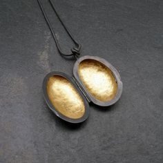 Sterling silver oxidized locket with 22ct yellow gold leaf, by Jenifer Wall. 30mm x 20mm