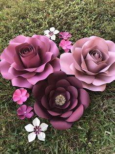 "Hand made paper flowers This set is perfect for your party decor, wedding decor, or home decor The flowers come in the styles you see in the pictures This listing includes 2 large flowers 16""-18"" 1 med flower 12-15"" 6 extra small flowers For custom orders message me,"
