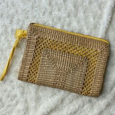 Yellow and straw clutch Make this your spring, summer, or vacation clutch! It's darling.  One interior pocket.  Preloved. One corner has some wear as shown in photo 3 but otherwise looks great! Mervyns Bags