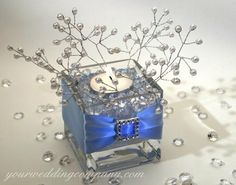 blue and silver centerpiece ~ love the square vase.