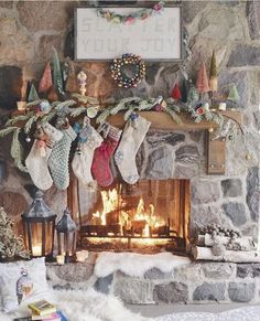 Rustic Christmas mantle with fresh greenery, bottle brush trees and stockings all in muted greens, creams and reds, Merry Little Christmas, Noel Christmas, Country Christmas, Winter Christmas, Vintage Christmas, Christmas Stockings, Christmas Porch, Outdoor Christmas, Christmas Presents