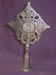 Handmade Ethiopian Coptic Christian processional cross accented with a priest engraving the spiritual emblem of Christian Ethiopia.