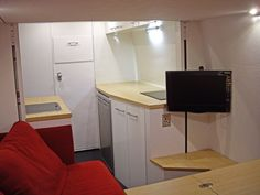 Lounge & kitchen in stealth Sprinter conversion