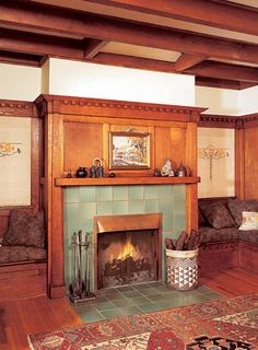 The History of the Fireplace: Bungalows and Arts & Crafts houses were known for their banquette-flanked hearths, often topped with copper hoods and faced with tile finished in earthy, mottled glazes. Fireplace Bookshelves, Small Fireplace, Fireplace Surrounds, Fireplace Design, Fireplace Hearth, Fireplace Ideas, Craftsman Fireplace Mantels, Fireplace Pictures, Basement Fireplace