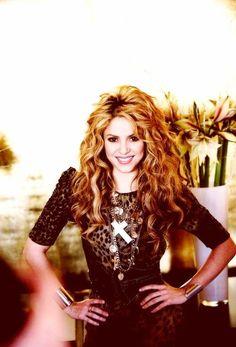Shakira.  I adore her.  She's so adorable.