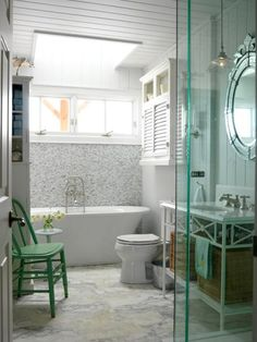 When that white-on-white color palette needs a shot of color, just add something small — nothing permanent or expensive. In this stunning bathroom mix of marble, mosaic tiling in various shades of white and gray, beadboard and porcelain, designer Sarah Richardson simply added a rustic grass-green chair in the corner. It adds a playful splash of color and breaks up the hard material elements.