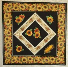 Advanced Embroidery Designs. Free Projects and Ideas. Quilted table set with autumn-themed machine embroidery.