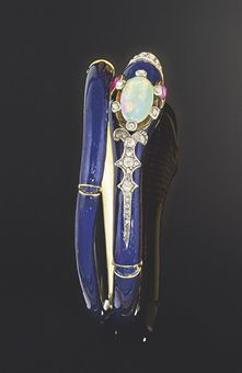 A Victorian gold, opal and diamond serpent bangle