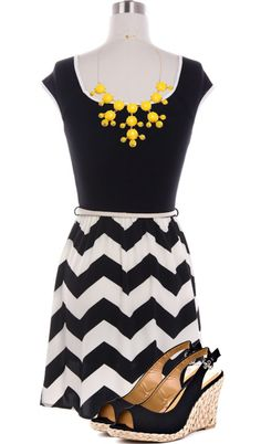 not in b + w (different color) but: statement necklace, chevron print on bottom, chunky wedge shoes . . .