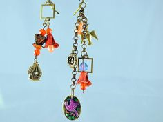 An assymetrical offering from Deb Beechy at Beetique!  Little charms, bsueboutiques.com