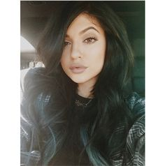 This face is a Kylie Jenner favorite, because it's great for accentuating your brow game, not to mention highlighting a glam eye. To achieve the asymmetrical look, just lift one brow, tilt your head, and pout your lips slightly.
