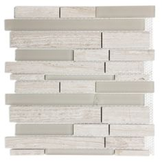 Use these beautifully modern mosaic tiles to build the perfect accent wall in your home or office. These contemporary tiles are made of natural gray stone accented with a frosted glass mosaic mix that is suitable for indoor or outdoor use.