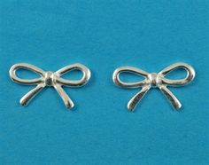 £12.00 incl tax  Sterling silver bow design stud earrings.  Approx 1.5cm across.