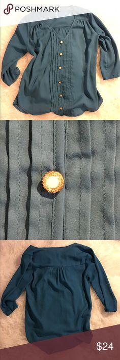 Francesca's Collections Button Pleated Blouse Preowned Francesca's Collections Blouse. Teal colored, with pleating in the center, and slight pleating sat shoulder and back. Beautiful buttons line the front. Measurements are approximately 25 inches in length and 19 inches across chest. 100% polyester, handwash or dry clean. Size small no trades. Francesca's Collections Tops Blouses