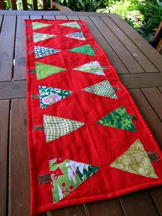 quilted tree table runner. I like the shape cut with pinking shears and appliqued.