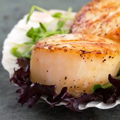 Succulent local scallops served with field greens and a ginger vinaigrette.