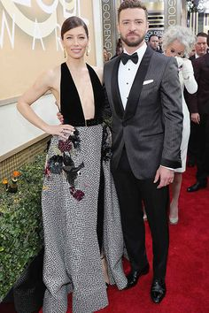 2017 golden globe awards justin timberlake grey tuxedo pinstripe coat with white dress shirt and black bow tie with black tuxedo pants and black dress shoes on the red carpet
