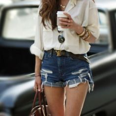 high rise shorts with sheer blouse and rolled up sleeves