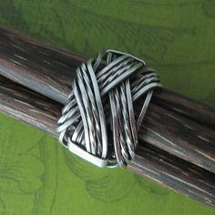 CROSSOVER RING - STERLING SILVER | Embracing. Interwoven. Sy… | Flickr