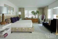Sophisticated but subdued, the master bedroom gives off the air of a five-star suite. The custom-designed bed (covered in Bramalta fabric) and nightstands, designed in conjunction with Bjork Studio, prove a showstopping anchor beneath a pair of square brass mirrors found at Decades. Vintage cork lamps from Pieces. Window treatments by Ferrick Mason.  http://www.atlantahomesmag.com/article/modern-family