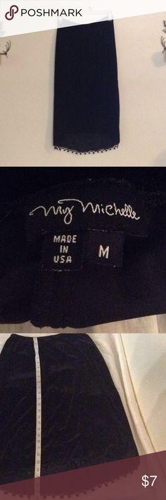 "Black velvet skirt with sequins Black velvet skirt with sequins partially along bottom. Sequins missing from roughly 6"" along hem on right side. Front of skirt from waist to hem is 24"" and back from waist to hem is 27 1/2"" size medium. My Michelle Skirts"
