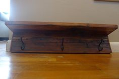 Reclaimed wood coat rack with shelf by BentNailCarpentry