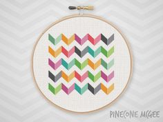 "Stitch this bright colorful chevron counted cross stitch pattern. Make this as an abstract geometric gift or a modern home decor wall hanging for yourself. This makes a great de-stash project for an advanced stitcher. Because this pattern only uses whole stitches, it is also easy for a beginner to tackle. The pattern is 75 by 75 stitches. Make sure to buy your aida cloth with a few inches extra for a border.  14 count aida – 5 ½"" x 5 ½"" (13.61 x 13.61cm)  16 count aida – 4 ¾"" x 4 ¾"" (11.91 x…"