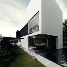 H-house, designed by Poland based architect, Tamizo architects group. The openings in the solid box are well organized and proportioned. Minimal design on the elevation as a result of complying the restrictions of the local law - maximum of 3 different materials on the elevation.
