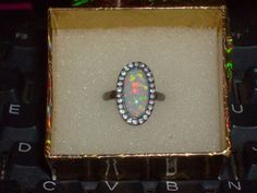 LOOK!!!! A GORGEOUS STAMPED 10K BGF WHITE FIRE OPAL AND AAA CZ RING SIZE 7