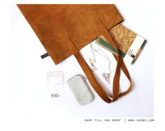 What do you carry in your bag? Notebook About Blanks, iPhone case by Keesis. HARDLEERS necklace & IWSBS Giftcard.