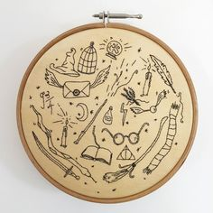 http://sosuperawesome.com/post/166146054634/harry-potter-hoop-art-by-gitta-kirschbaum-on-etsy