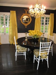yellow curtain dining room interior inspiration with black rounded table and wall with white chair