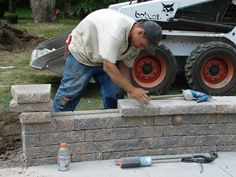 How to Build a Kidney Shaped Patio and Sitting Wall : How-To : DIY Network
