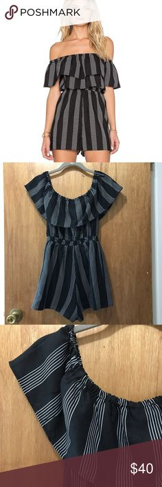 Luca Couture Romper Super cute romper by Luca Couture. I only wore it 2-3 times so it's like-new condition. The elastic waistband is really comfortable on the waist. Great off the shoulder style. Lucca Couture Dresses