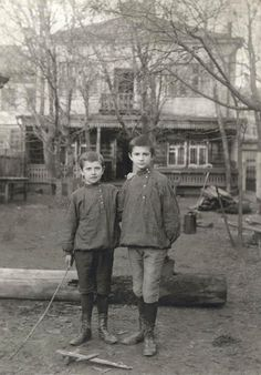 1900-1910 | Unknown author. Portrait of 2 boys in Russian national shirts standing outdoors | Moscow House of Photography collection