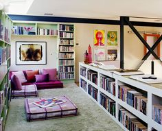 Library with reading area large oversized plaid floor pillows and plush carpet. Designed by Schuyler Samperton Interior Design